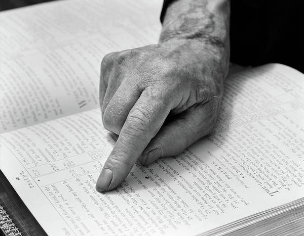 Scripture Photograph - 1940s Hand Of Elderly Man Reading Bible by Vintage Images