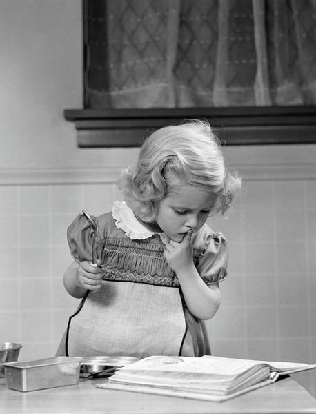 Think Photograph - 1940s Little Girl Playing In Kitchen by Vintage Images