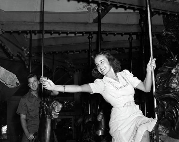 Girl And Horse Photograph - 1940s Smiling Woman On Carousel by Vintage Images