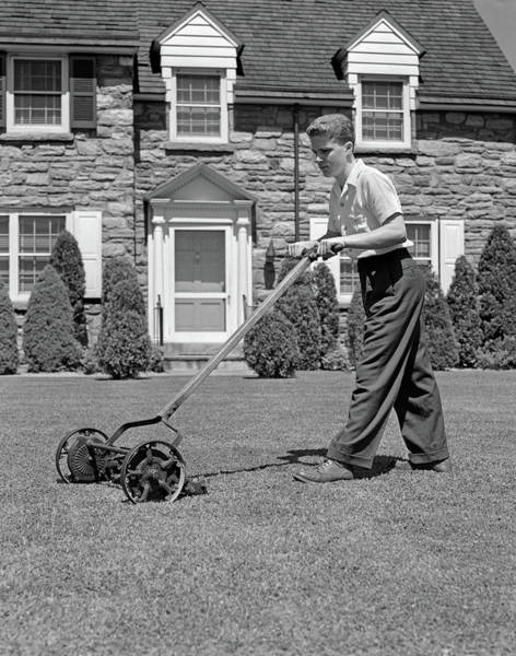 Wall Art - Photograph - 1940s Teenage Boy Mowing Grass Pushing by Vintage Images
