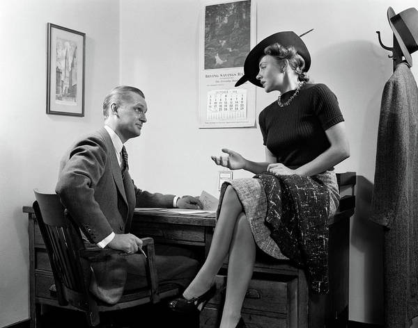 Suggestion Photograph - 1940s Woman Sitting On Desk Hat Skirt by Vintage Images