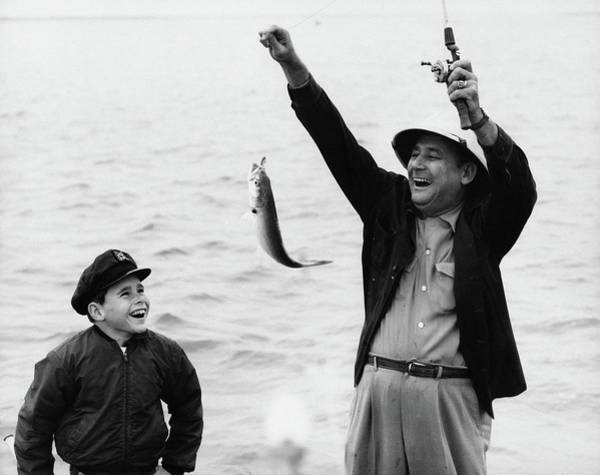 Father Photograph - 1950s 1960s Boy Son Fishing With Man by Vintage Images