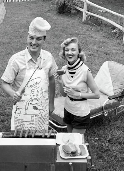 Buns Photograph - 1950s 1960s Couple Backyard Grilling by Vintage Images