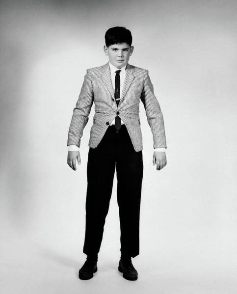 Tight Pants Photograph - 1950s 1960s Overgrown Boy In Too Tight by Vintage Images