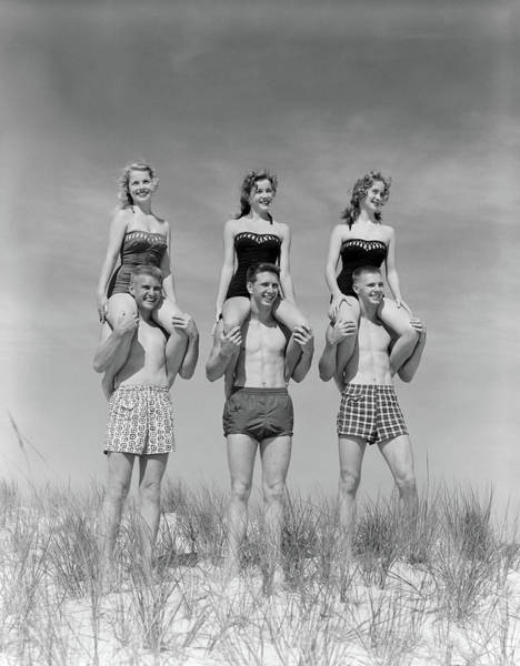 Wall Art - Photograph - 1950s 1960s Three Couples At Beach by Vintage Images