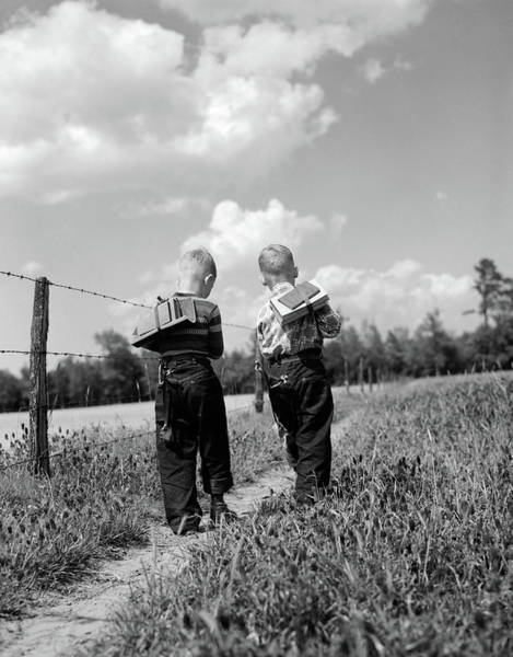 Best Friend Photograph - 1950s Back View 2 Boys With Book Packs by Vintage Images