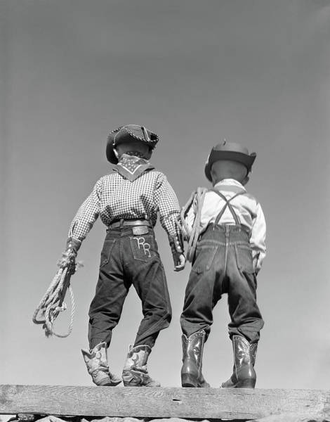 Western Costume Photograph - 1950s Back View Of Two Boys Dressed by Vintage Images