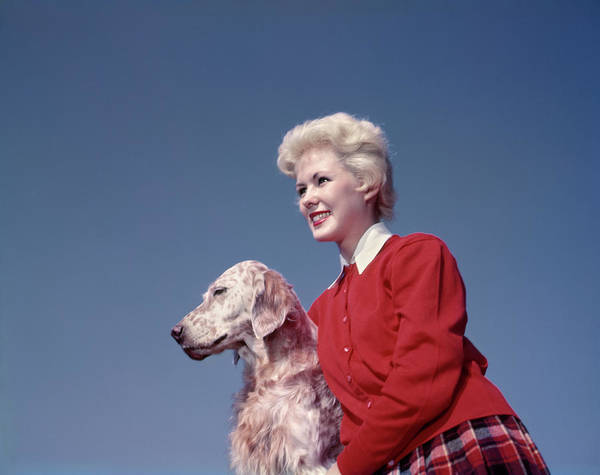 Setters Photograph - 1950s Blond Woman In Red Sweater by Animal Images