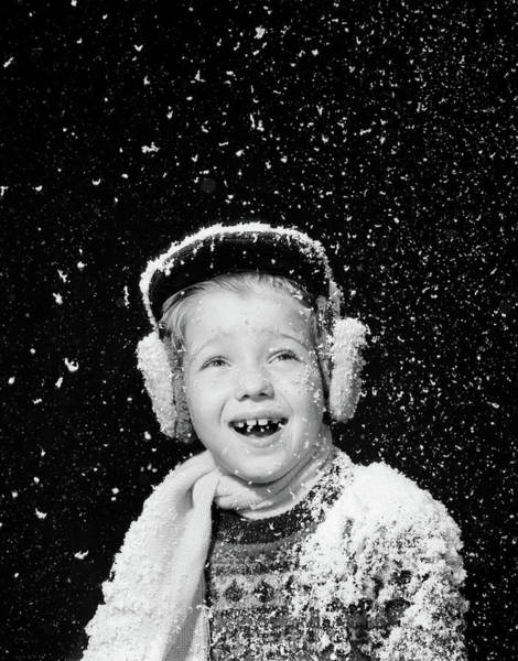 Ear Muffs Photograph - 1950s Boy Catching Snowflakes In Open by Vintage Images