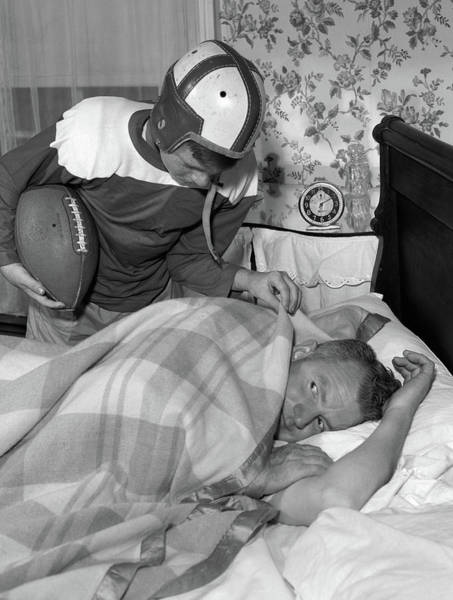 Wake Up Photograph - 1950s Boy In Football Uniform Waking by Vintage Images