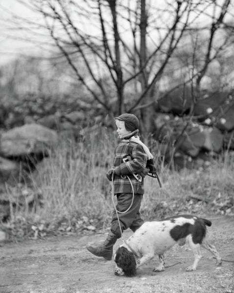 Springer Spaniel Photograph - 1950s Boy Wearing Winter Coat Hat Scarf by Animal Images