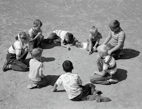 Shooters Wall Art - Photograph - 1950s Boys & Girls Shooting Marbles by Vintage Images