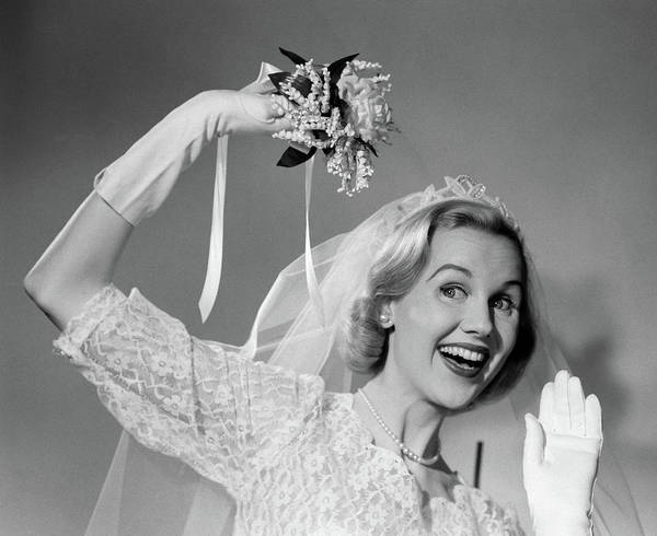 Wedding Bouquet Photograph - 1950s Bride Throwing Bouquet And Waving by Vintage Images