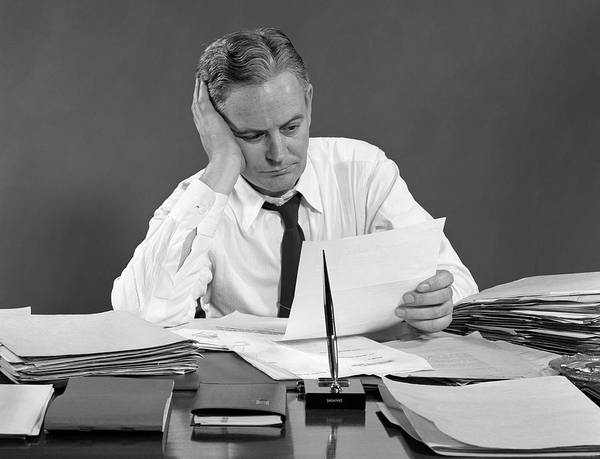 Weary Photograph - 1950s Businessman At Desk Reading by Vintage Images