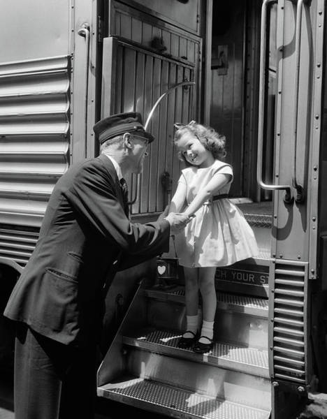 Wall Art - Photograph - 1950s Conductor Greeting Little Girl by Vintage Images