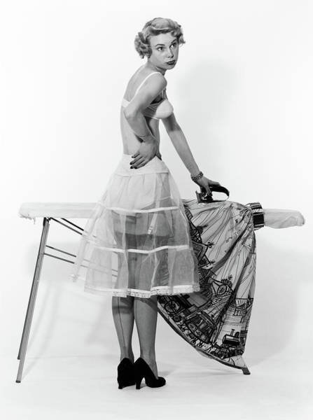 Dressing Photograph - 1950s Distracted Woman Wearing by Vintage Images