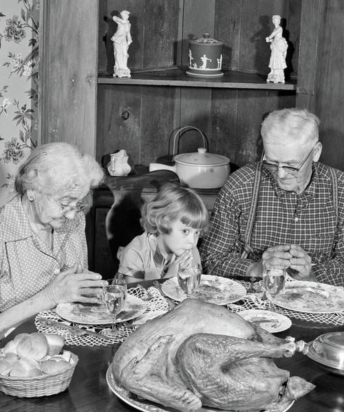Saying Photograph - 1950s Family Thanksgiving Dinner by Vintage Images