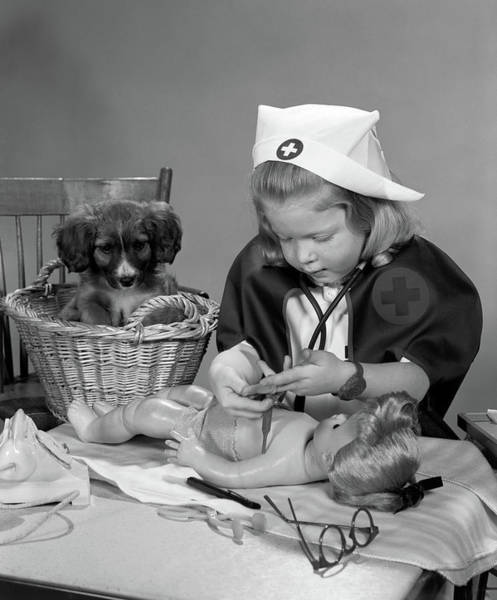 Dog Watch Photograph - 1950s Girl Wearing Nurses Uniform by Vintage Images