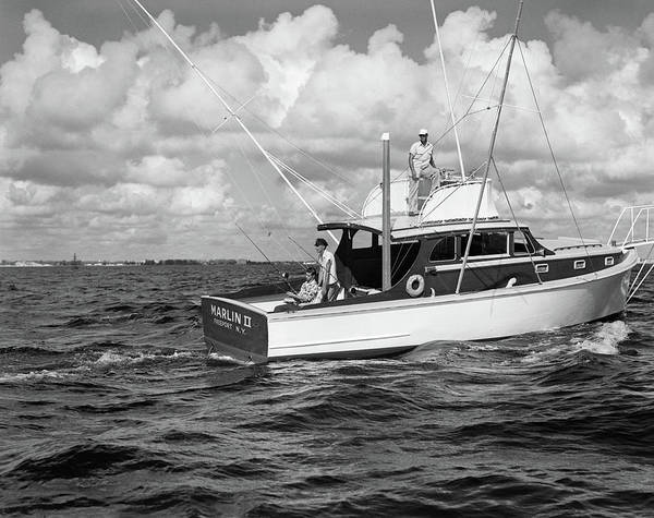 Powerboat Photograph - 1950s Group Of 3 Men Trolling by Vintage Images