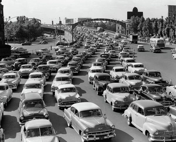 Wall Art - Photograph - 1950s Heavy Traffic Coming by Vintage Images