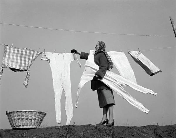 Clothesline Photograph - 1950s Housewife Removing Frozen Long by Vintage Images
