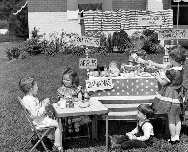 Candy Apples Wall Art - Photograph - 1950s Kids In Backyard Playing Store by Vintage Images
