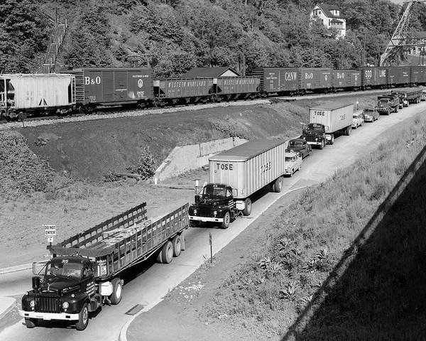 Trailer Photograph - 1950s Line Of Traffic With Many Trucks by Vintage Images