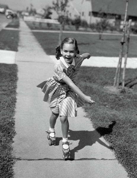 Agile Photograph - 1950s Little Girl Roller-skating by Vintage Images