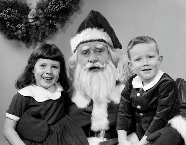 Jolly Holiday Photograph - 1950s Man Santa Claus Posing With Young by Vintage Images