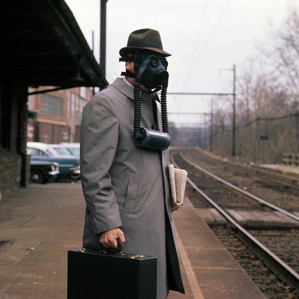 Railroad Station Photograph - 1950s Man Wearing Gas Mask Hat by Vintage Images