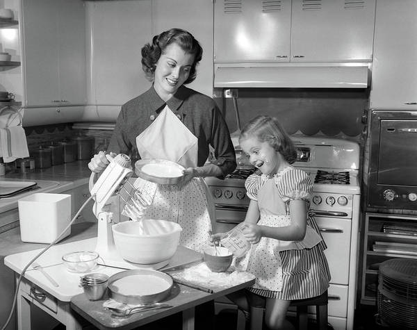 Single Parent Wall Art - Photograph - 1950s Mother & Daughter Baking A Cake by Vintage Images