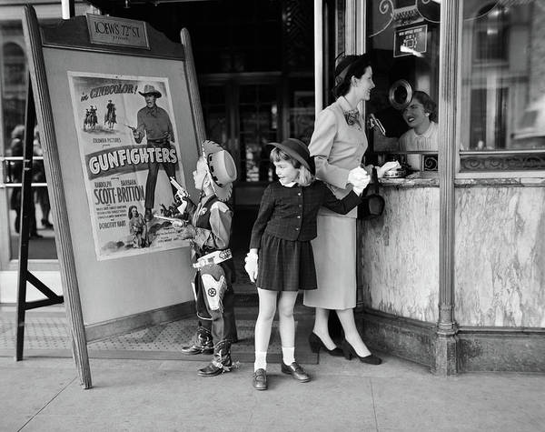 Gunfight Wall Art - Photograph - 1950s Mother 2 Children Buying Tickets by Vintage Images