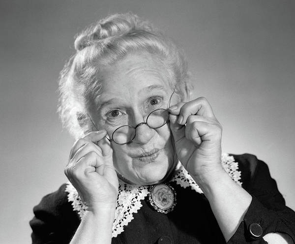 Buns Photograph - 1950s Portrait Of Smiling Old Lady by Vintage Images