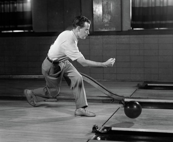Ten Pin Bowling Wall Art - Photograph - 1950s Side View Man Bowling Releasing by Vintage Images