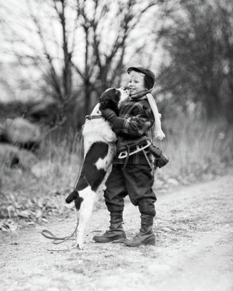 Springer Spaniel Photograph - 1950s Smiling Boy Wearing Winter Coat by Animal Images