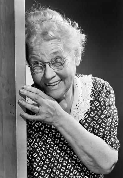 Sneak Photograph - 1950s Smiling Elderly Woman Peeking by Vintage Images