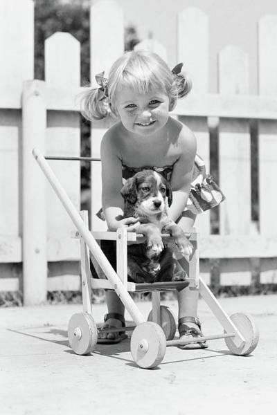 Springer Spaniel Photograph - 1950s Smiling Girl With Blonde Pigtails by Vintage Images