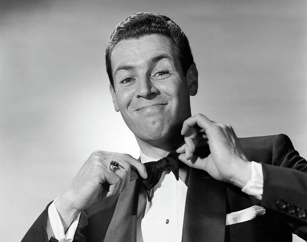 Perky Photograph - 1950s Smiling Man In Tuxedo Tying Black by Vintage Images