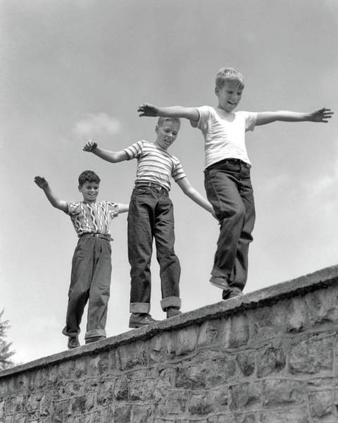 Balancing Rocks Photograph - 1950s Three Laughing Boys Walking by Vintage Images