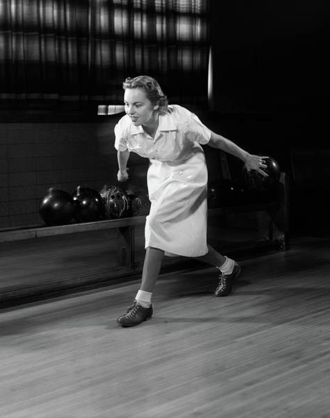 Bowling Alley Photograph - 1950s Woman Bowling About To Release by Vintage Images