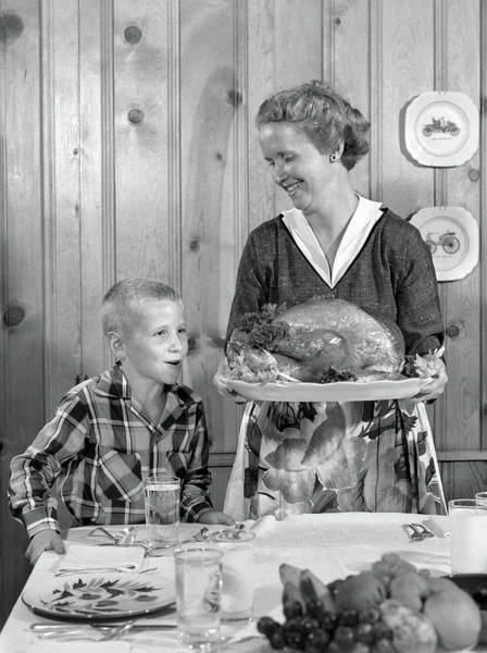 Parental Care Photograph - 1950s Woman In Apron Putting Turkey by Vintage Images