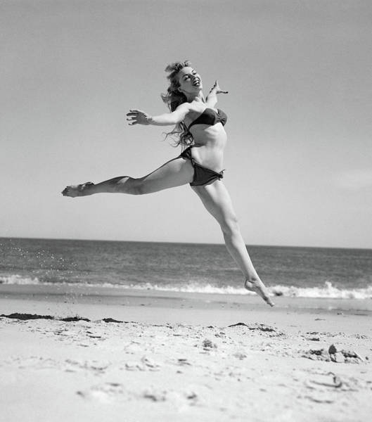 Dancing Water Photograph - 1950s Woman In Bikini Running by Vintage Images
