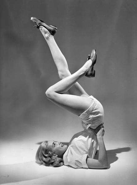 Workout Photograph - 1950s Woman In Shorts Exercising Legs by Vintage Images