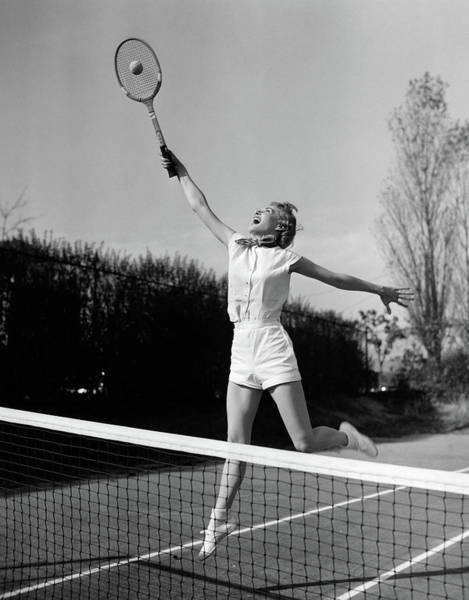 Esteem Photograph - 1950s Woman Jumping To Hit Tennis Ball by Vintage Images