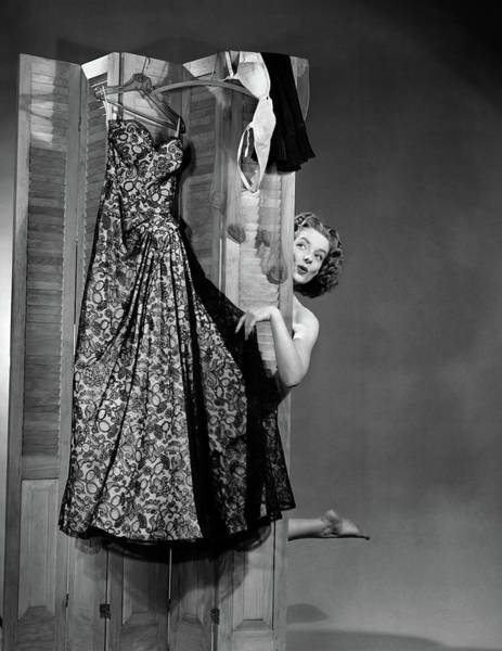 Dressing Photograph - 1950s Woman Peeking From Behind Screen by Vintage Images