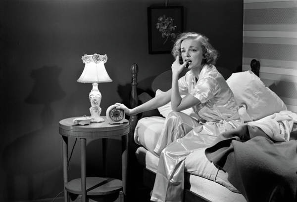 Sleep Disorder Photograph - 1950s Woman Silk Pajamas Sitting Edge by Vintage Images