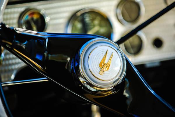 Photograph - 1957 Studebaker Golden Hawk Supercharged Sports Coupe Steering Wheel Emblem by Jill Reger