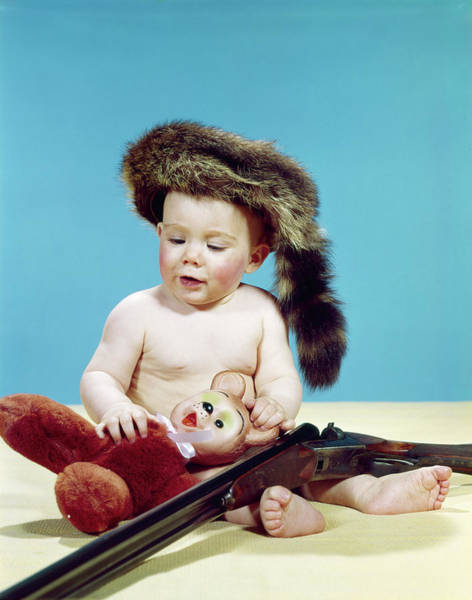 Space Gun Photograph - 1960s Baby Boy Wearing Coonskin Cap by Vintage Images