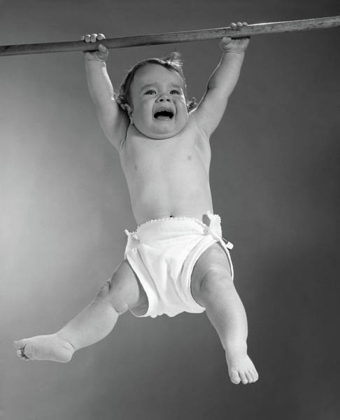 Hands Of Time Photograph - 1960s Baby Hanging From Rod by Vintage Images
