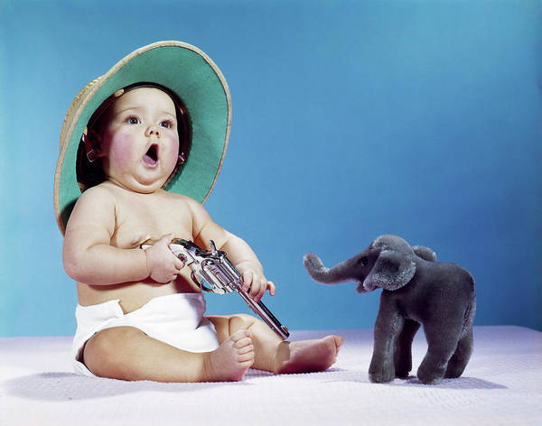 Space Gun Photograph - 1960s Baby Wearing Pith Helmet Holding by Vintage Images
